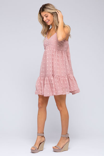 woman in pink baby-bump-friendly babydoll dress