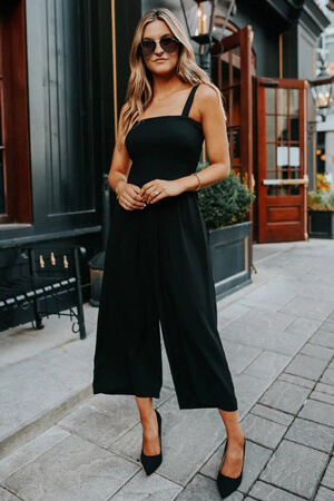 woman wearing black cropped jumpsuit