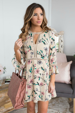 Cute beige floral dress with cutouts
