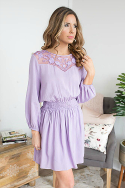 Lavender dress with a gathered waist and lace detail