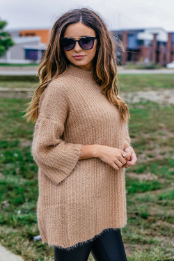 light brown sweater and sunglasses