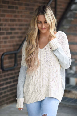 girl wearing tan and grey sweater