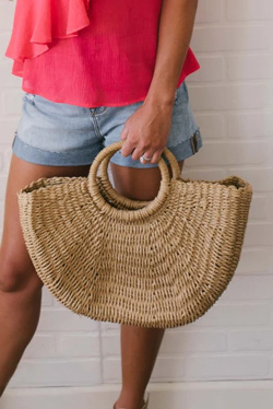 woven handbag with wooden handle