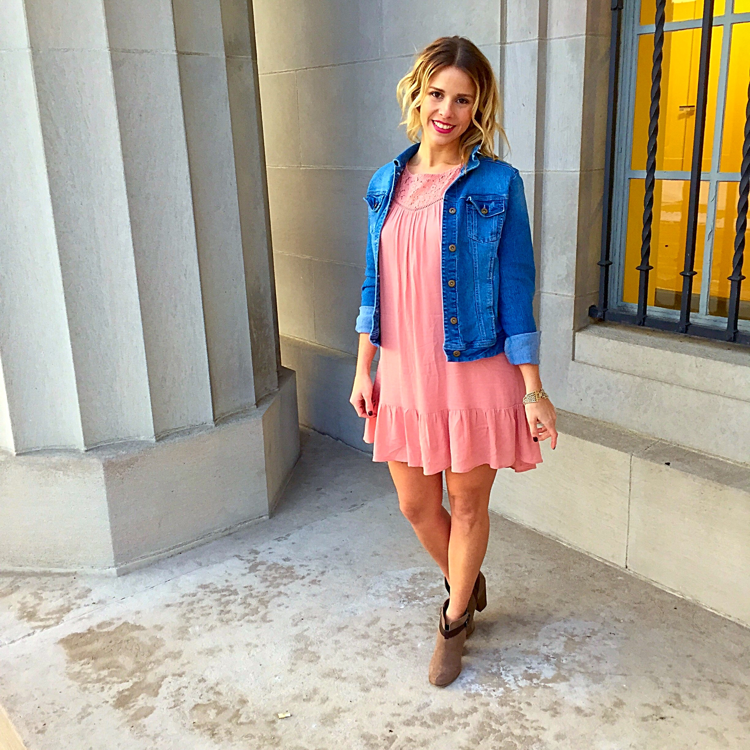Woman in pink dress and jean jacket