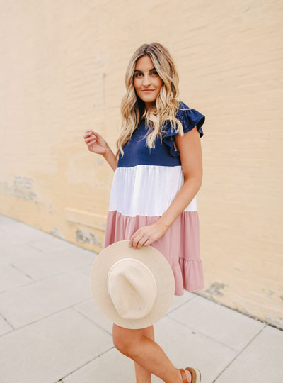 woman in tiered blue white pink dress
