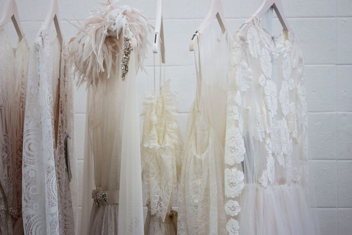occasion dresses in shades of white hanging up