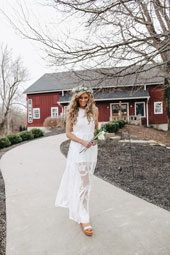 woman in white maxi dress with bouquet